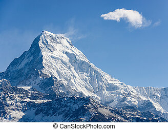 Annapurna South in Nepal - The Annapurna South, blue sky and...