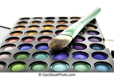 Eye shadow palette with green brush