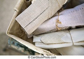 Old linen cloths in a flea market in France
