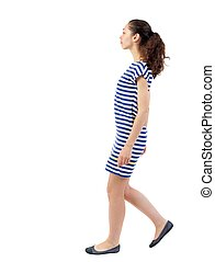 back view of walking curly woman. - back view of walking...