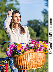Young girl with a bicycle