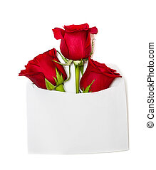 Beautiful rose with vintage envelope on wooden background