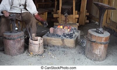 blacksmith working at smithy
