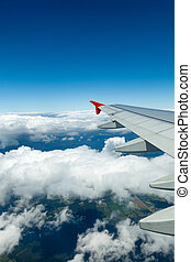 Above the clouds.Wing aircraft in the sky. - Above the...