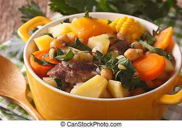 South American cuisine: Puchero soup with chickpeas close-up...