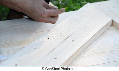 Work lefty makes wooden gate from wooden planks - Work lefty...