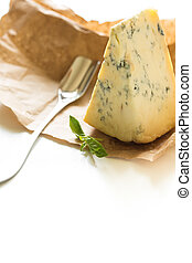 Stilton cheese on a white background. - Slice of blue...