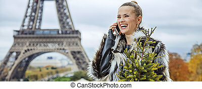 fashion-monger with Christmas tree speaking on mobile, Paris...