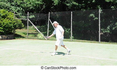 demonstration forehand tennis - middle age senior man...