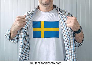 Man wearing white shirt with Sweden flag print - Man wearing...