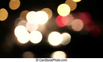 Abstract blurred colorful circles night traffic de-focused...