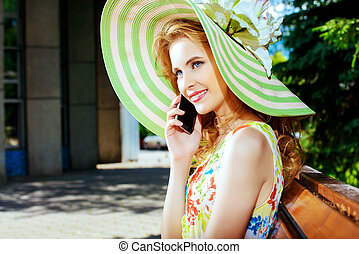 pleasant phone call - Pretty smiling girl is talking on the...