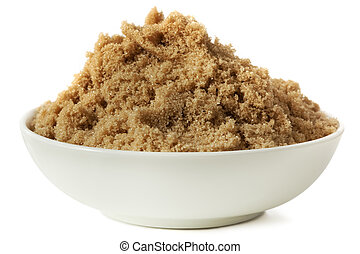 Brown Sugar - Small bowl of brown sugar, isolated on white.