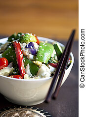 Stir-Fried Vegetables - Stir-fried vegetables in a bowl with...