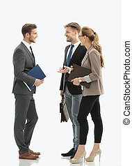 Image of business partners discussing ideas at meeting -...