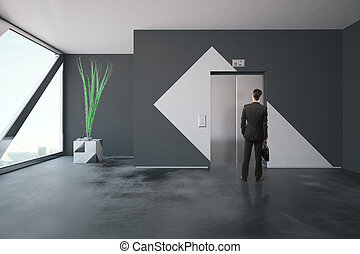 Businessman in front of elevator - Businessman with...