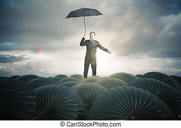 Business protection concept - Businessman with black...