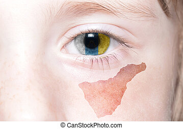human's face with national flag and map of tenerife.