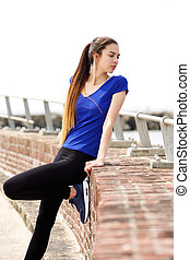 Attractive sporty woman looking over shoulder - Portrait of...