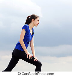 Athletic woman workout routine outside