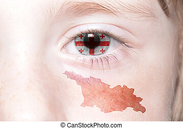 human's face with national flag and map of georgia.