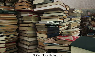 Pile of Books Scattered on the Floor in the Library. A stack...