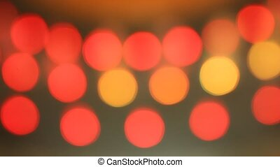 Bokeh of fountain lights with color effect reflected on...
