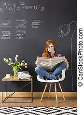 Ration of daily informations - Red-haired woman sitting...