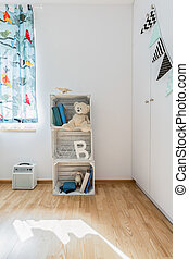 Crates of young explorers - Part of a child room with window...