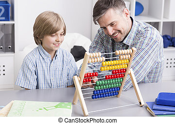 Maths? It's easy! - Shot of a man and his son using an...