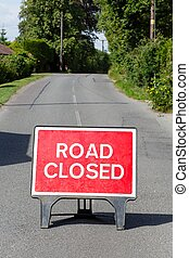 Road closed sign - Road sign on a street showing a road...