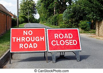 Detour, blocked road - Road signs showing a street closed in...