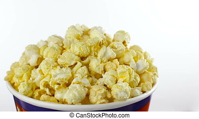 Salt popcorn in box on white background, rotation, close up...