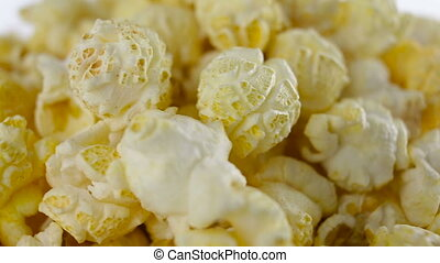 Salt popcorn in box on white background, rotation, very...