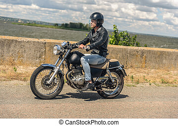 Young man riding his motorbike on open road - Let is get out...