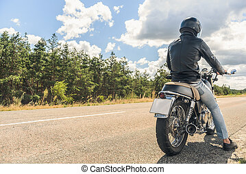 Young man sitting on his motorbike - Taking journey Rear...