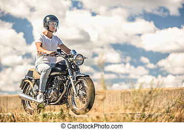 Young man riding his motorbike on open road - Everything is...