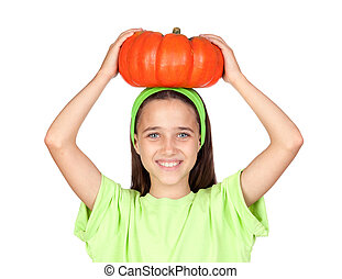 Happy girl in Halloween with a big pumpkin isolated on white...