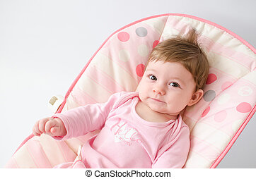 baby girl on a bouncer - beautiful happy baby girl in a...