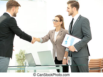 Business people shaking hands in an office - Successful...