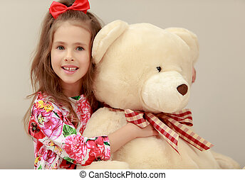 Girl with Teddy bear - Gentle little girl with a long...
