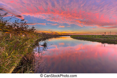 Pink and orange river sunset - Colorful pink and orange...