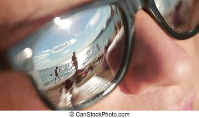 young beautiful girl in sunglasses. beach reflection....