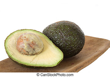 Avacado on wooden board in isolated over white