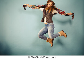Attractive woman is jumping up. - Movement fun and fashion...