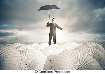 Business protection concept - Businessperson with white...