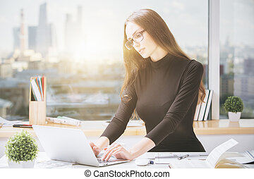 Young businesslady using laptop - Portrait of gorgeous young...