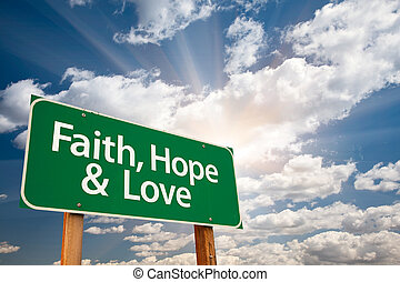 Faith, Hope and Love Green Road Sign with Dramatic Clouds,...