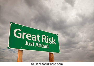 Great Risk Green Road Sign Over Storm Clouds