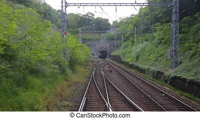 Railway track motion - Train journey passing a tunnel